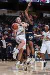 Alex Sharp (14) of the Wake Forest Demon Deacons drives the baseline past Kaylan Pugh (1) of the Georgia Tech Yellow Jackets during first half action at the LJVM Coliseum on January 22, 2017 in Winston-Salem, North Carolina.  The Demon Deacons defeated the Yellow Jackets 70-65 in overtime.  (Brian Westerholt/Sports On Film)