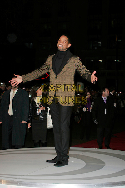 "WILL SMITH.The UK film premiere of ""Seven Pounds"" at the Empire Cinema, Leicester Square, London, England..January 14th 2009.full length black polo neck jumper top brown collar lapel plaid check checked jacket blazer hands arms outstretched .CAP/AH.©Adam Houghton/Capital Pictures."