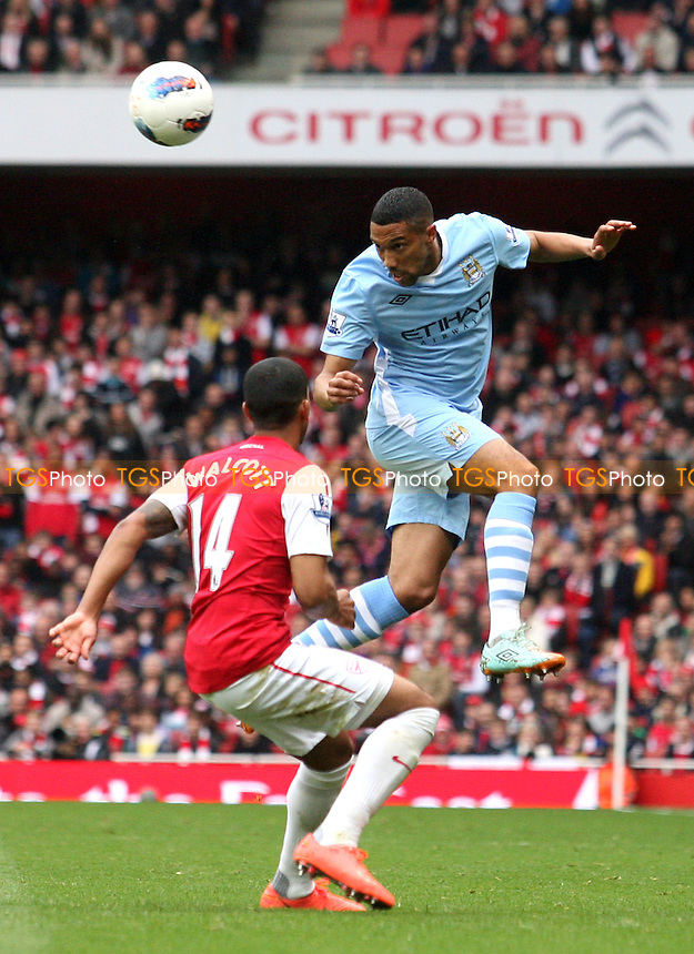 Gael Clichy of Manchester City and Theo Walcott of Arsenal -  Arsenal - Manchester City at the Emirates Stadium - 08/04/12 - MANDATORY CREDIT: Dave Simpson/TGSPHOTO - Self billing applies where appropriate - 0845 094 6026 - contact@tgsphoto.co.uk - NO UNPAID USE.