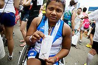 Minda holds up her race results after completing the Aquaphor New York City Triathlon in New York on July 8, 2012.
