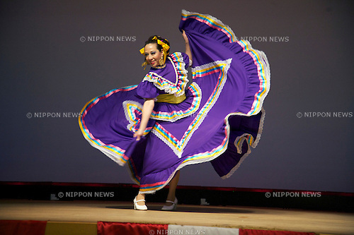 "Minamisanriku, Miyagi, Japan - A Mexican woman with traditional dress dances for Japanese refugees at Sports Koryu Mura in Minamisanriku, one year after the tsunami. The Latin group of volunteers ""Todos con Japon"" visits Miyagi area during this Golden Week."