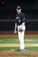 Wake Forest Demon Deacons relief pitcher Shane Muntz (11) looks to his catcher for the sign against the Notre Dame Fighting Irish at David F. Couch Ballpark on March 10, 2019 in  Winston-Salem, North Carolina. The Fighting Irish defeated the Demon Deacons 8-7 in 10 innings in game two of a double-header. (Brian Westerholt/Four Seam Images)