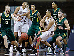 SIOUX FALLS, SD: MARCH 20:  David Chavlovich #1 of West Texas A&M passes around Le Moyne defenders  Tanner Hyland #13, Daniel Kaigler #31 and Russell Sangster #1 during their game at the 2018 Division II Men's Elite 8 Basketball Championship at the Sanford Pentagon in Sioux Falls, S.D. (Photo by Dick Carlson/Inertia)