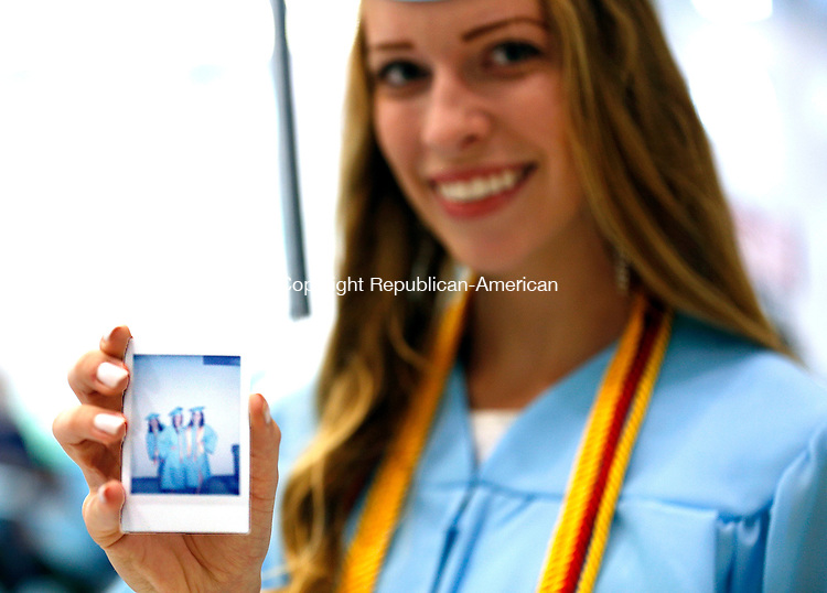 Oxford, CT- 15 June 2015-061515CM06-  Oxford High School graduate Anne Dennen shows of an instant photograph of fellow graduates before the start commencement exercises in Oxford on Monday.   Christopher Massa Republican-American