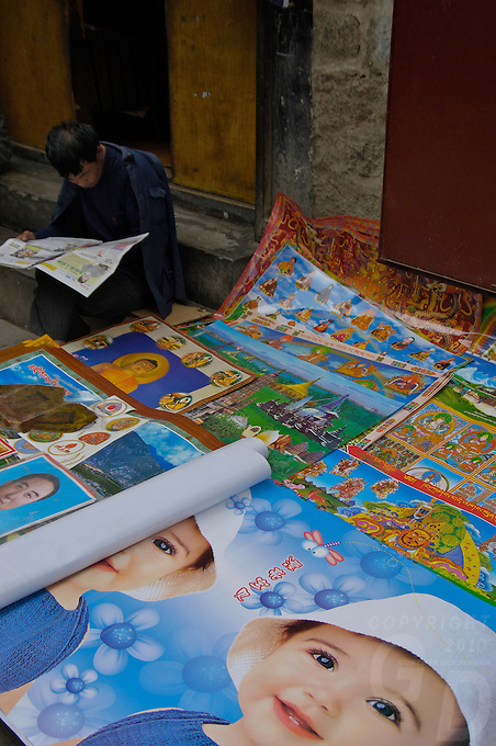 A poster vendor in the streets of Lhasa, Tibet