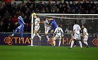 Pictured: Steven Caulker of Swansea (2nd L) is heading the ball away after a David Luiz of Chelsea header (L). Tuesday, 31 January 2012<br />