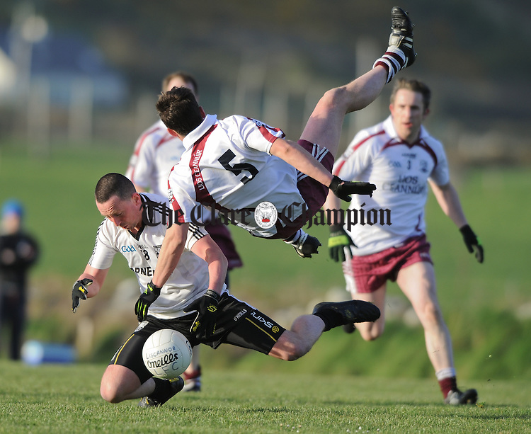 Brian Conway of Ennistymon in action against Shane Canavan of Liscannor during their Cusack Cup game at Liscannor. Photograph by John Kelly.