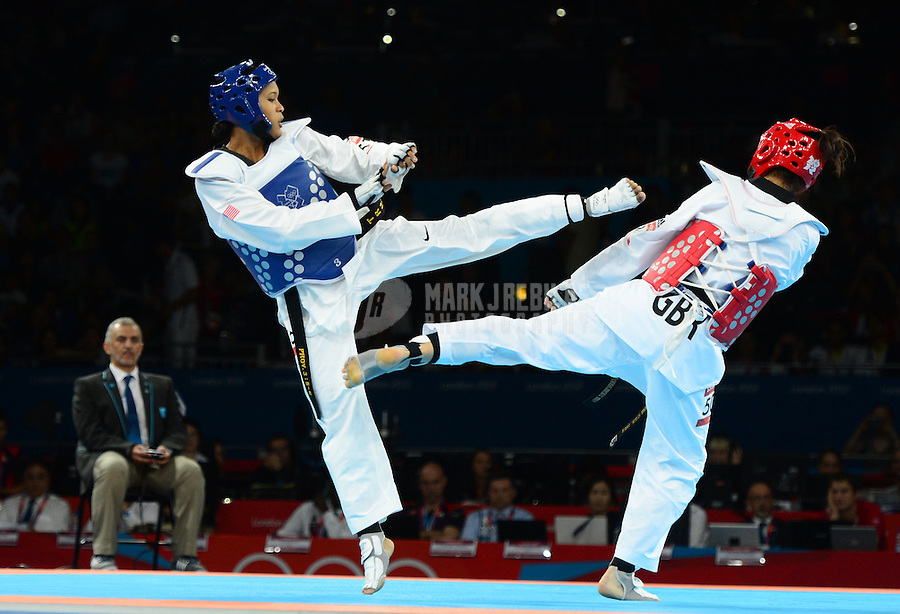Aug 10, 2012; London , United Kingdom; Paige McPherson (USA), left, against Sarah Stevenson (GBR) in the women's 67kg preliminary during the London 2012 Olympic Games at ExCeL - South Arena 1. Mandatory Credit: Mark J. Rebilas-USA TODAY Sports
