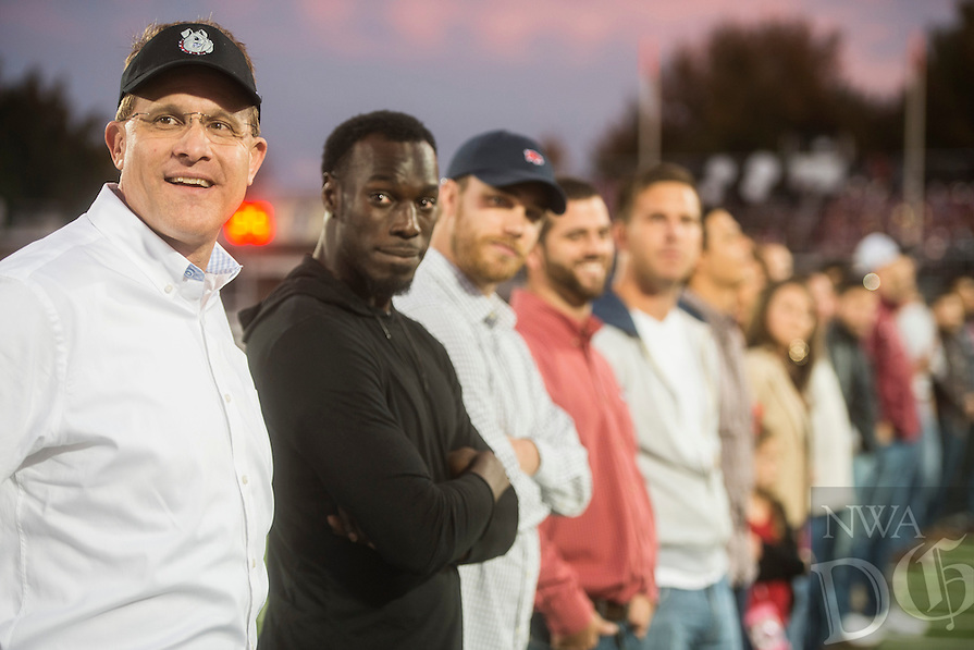 NWA Democrat-Gazette/ANTHONY REYES &bull; @NWATONYR<br /> Gus Malzahn (left) former Springdale head football coach talks with former players from the 2005 season Friday, Oct. 23, 2015 before the game against Fort Smith Northside at Jarrell Williams Bulldog Stadium in Springdale.