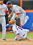 11 April 2012: Washington Nationals infielder Danny Espinosa gets the out at second, but has the double-play broken up by a sliding Kirk Nieuwenhuis during a game against the New York Mets at Citi Field in Flushing, New York. The Nationals shut out the Mets 4-0 to take the rubber match of their 3-game series. Mandatory Credit: Ed Wolfstein Photo