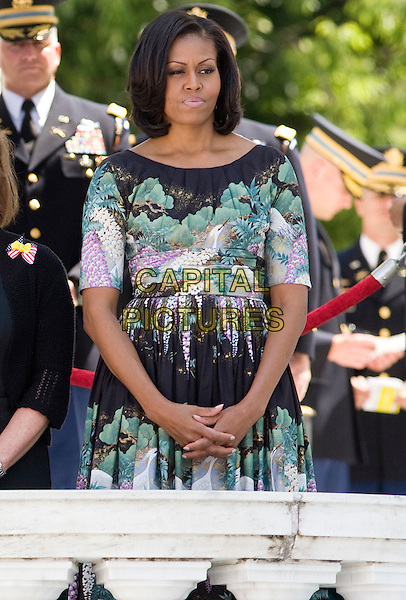 First lady Michelle Obama attends a Memorial Day ceremony at Arlington National Cemetery in Arlington, Virginia on Monday, May 28, 2012.   .half length black green white purple print dress .CAP/ADM/KT.©Kristoffer Tripplaar/Pool/CNP/AdMedia/Capital Pictures.