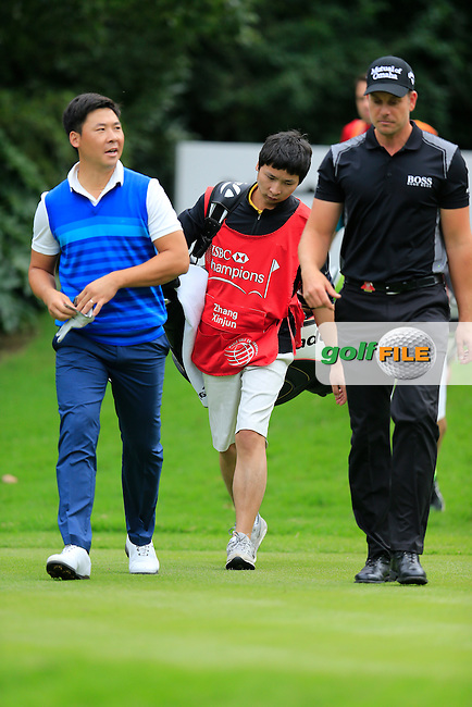 Henrik Stenson (SWE) and, Zhang Xinjun (CHN) walking off the 5th tee during the final round of the WGC-HSBC Champions, Sheshan International GC, Shanghai, China PR.  30/10/2016<br /> Picture: Golffile | Fran Caffrey<br /> <br /> <br /> All photo usage must carry mandatory copyright credit (&copy; Golffile | Fran Caffrey)