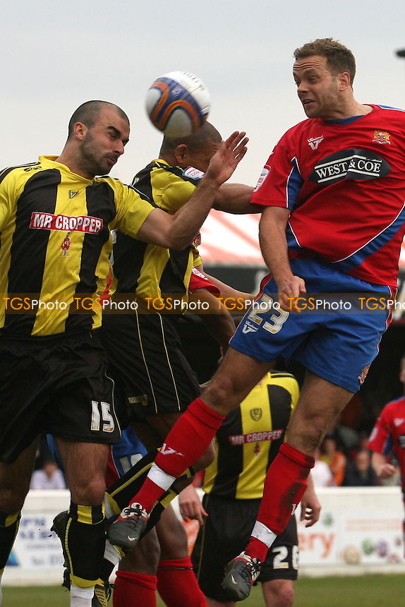Ryan Austin of Burton Albion and Brian Woodall of Dagenham and Redbridge -  Dagenham and Redbridge vs Burton Albion - at the London Borough of Barking and Dagenham Stadium - 06/04/12 - MANDATORY CREDIT: Dave Simpson/TGSPHOTO - Self billing applies where appropriate - 0845 094 6026 - contact@tgsphoto.co.uk - NO UNPAID USE.
