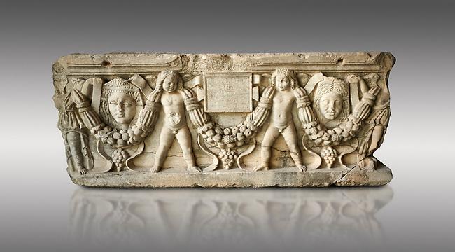 Roman relief sculpted garland sarcophagus with cherubs, 3rd century AD. Adana Archaeology Museum, Turkey. Against a grey background