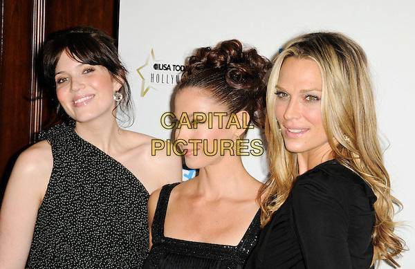 MANDY MOORE, ASHLEY JUDD & MOLLY SIMS.at the USA Today 4th Annual Hollywood Hero Award Honors at the Montage Beverly Hills in Beverly Hills, California, USA, November 10th 2009..portrait headshot one shoulder black and white hair up bun gold earrings polka dot .CAP/ROT.©Lee Roth/Capital Pictures