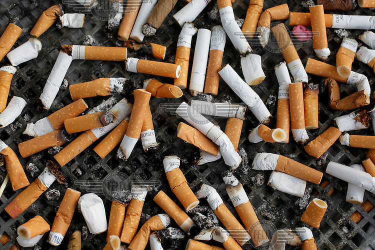 Cigarette butts litter the floor.