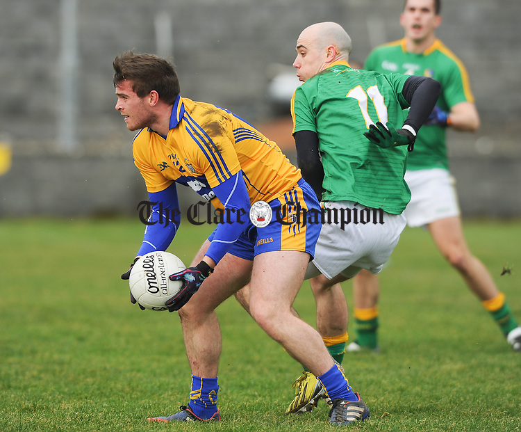 Sean Collins of Clare in action against Robert Lowe of Leitrim during their Round 2 Division 4 national Football League game at Miltown Malbay. Photograph by John Kelly.
