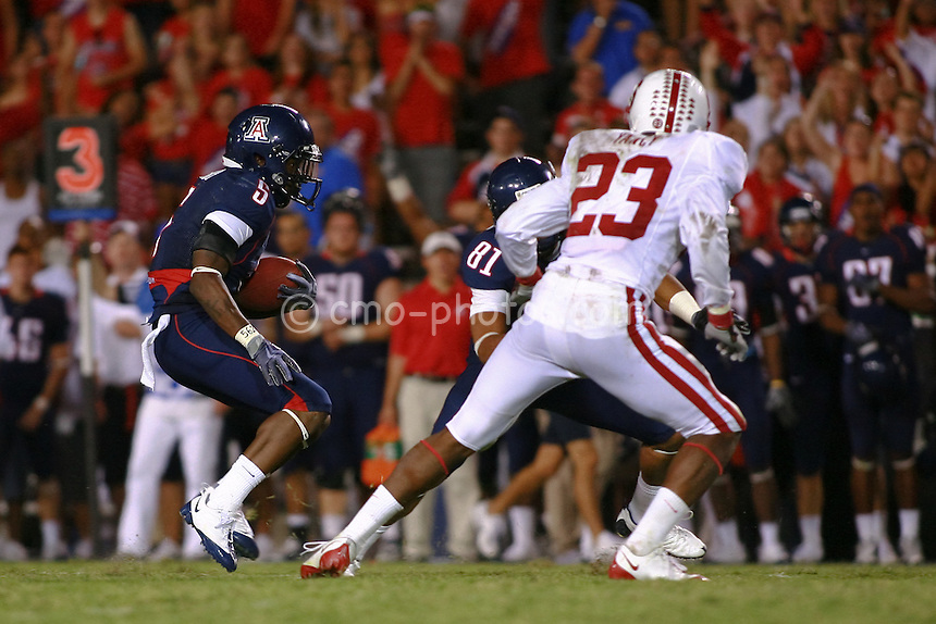 Oct 17, 2009; Tucson, AZ, USA; Arizona wide receiver David Roberts (81) blocks Stanford safety Austin Yancy (23) which allows Arizona running back Nic Grigsby (5) to run for 57 yards and the game-winning touchdown in the 4th quarter of a game at Arizona Stadium.  Arizona defeated Stanford 43-38.