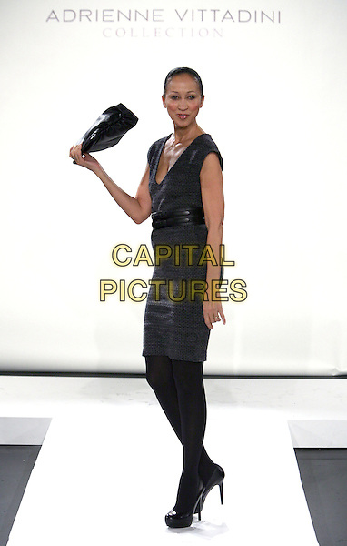 PAT CLEVELAND .Adrienne Vittadini Presentation MBFW Fall 2011 at Lincoln Center, New York, NY, USA, 16th February 2011..full length fashion catwalk runway model modeling black dress tights bag .CAP/ADM/PZ.©Paul Zimmerman/AdMedia/Capital Pictures.