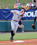 Third baseman Rob Lyerly (16) of the Charleston RiverDogs twists and turns to catch a pop fly in a game against the Greenville Drive on May 27, 2010, at Fluor Field at the West End in Greenville, S.C.