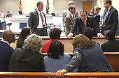 Prosecutor Richard Conway,  leaning on rail, talks to the family of sniper victim Conrad Johnson during a break in the trial of sniper suspect John Allen Muhammad at the Virginia Beach Circuit Court, Virginia Beach, Virginia on October 22, 2003.  Johnson was a Maryland bus driver who was shot and killed one year ago today. <br /> Credit: Davis Turner - Pool via CNP