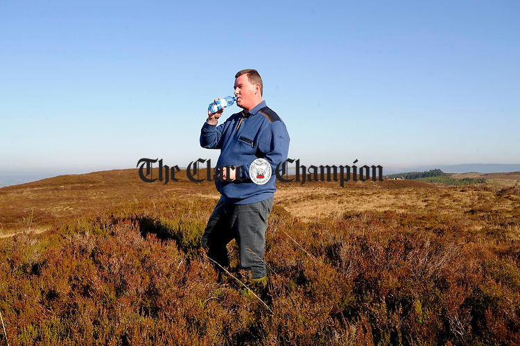 Councillor Pat Hayes takes in the view on top of Ballycroum mountain in Feakle. Photograph by John Kelly.