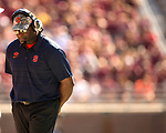 Syracuse head coach Dino Babers paces the sidelines in the first half of an NCAA college football game against Florida State in Tallahassee, Fla., Saturday, Nov. 4, 2017.  Florida State defeated Syracuse 27-24. (AP Photo/Mark Wallheiser)