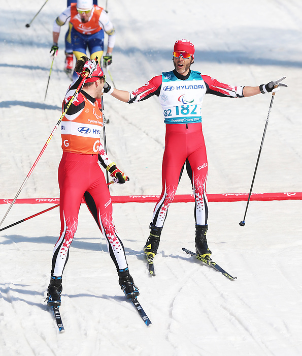 Pyeongchang, Korea, 14/3/2018-Brian McKeever and Russell Kennedy compete in the cross country sprints during the 2018 Paralympic Games in PyeongChang. Mckeever wins gold. Photo Scott Grant/Canadian Paralympic Committee.