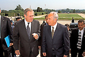 United States Secretary of Defense Donald H. Rumsfeld (left) escorts Israeli Minister of Foreign Affairs Shimon Peres into the Pentagon in Washington, DC on August 1, 2002.  The two men will meet to discuss a range of issues of concern to both nations.  <br /> Mandatory Credit: Robert D. Ward / DoD via CNP