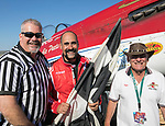 Jay Conslvi,center, from Lakewood, CO with plane owner Tiger Destefani, left, and flagman Dale Tucker, won the Unlimited Gold Championship in his P-51 Strega during the National Championship Air Races in Reno, Nevada on Sunday, Sept. 17, 2017.
