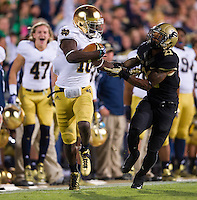 The Irish scored again quickly in the fourth quarter as DaVaris Daniels caught a Tommy Rees pass and held of Purdue Boilermakers cornerback Ricardo Allen (21) on his way to the end zone for Notre Dame's third TD.