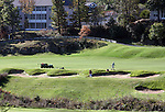 Workers taking care of the landscaping of a golf course in Branson Missouri during the Fall season