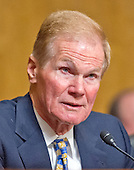 """United States Senator Bill Nelson (Democrat of Florida) listens as John Koskinen, Commissioner, Internal Revenue Service, testifies before the United States Senate Committee on Finance on """"IRS Operations and the President's Budget for Fiscal Year 2016"""" in Washington, D.C. on Tuesday, February 3, 2015.  During his testimony, Koskinen said """"In regard to software, we still have applications that were running when John F. Kennedy was President.""""<br /> Credit: Ron Sachs / CNP"""