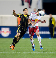 Dilly Duka (11) of the Columbus Crew fights for the ball with Matt Kassel (15) of the New York Red Bulls during the game at Red Bull Arena in Harrison, NJ.  The New York Red Bulls tied the Columbus Crew, 1-1.