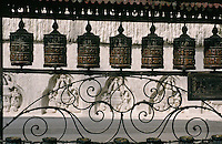There is evidence that the Swayambhunath Stupa in the hills near Kathmandu was an important Buddhist pilgrimage destination by the 5th century but its origins date back to a much earlier time before Buddhism reached the valley. These are prayer wheels that are to be spun by visiting worshippers.