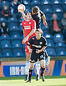 Raith's Brian Graham (red) is challenged by Partick's Aaron Muirhead (top) and Hugh Murray (10) ...