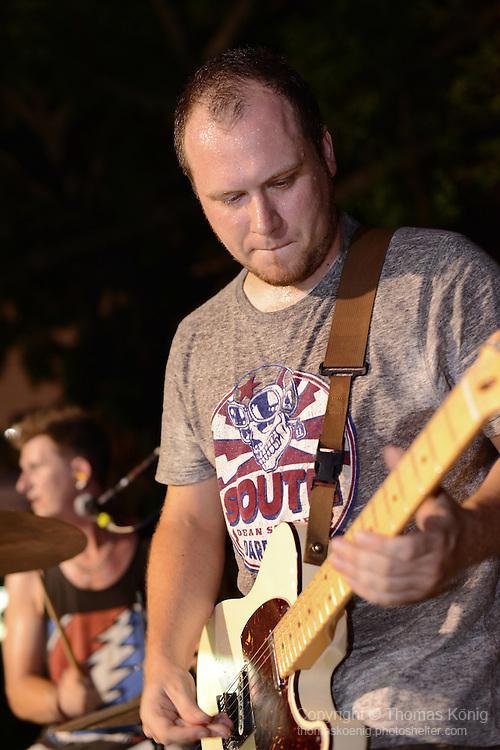 Kaohsiung, Taiwan -- Guitarist Paul Dymott of British Rock 'n' Roll band GOOBER GUN durinmg a performance at the Brickyard Beer Garden.