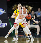 SIOUX FALLS, SD - MARCH 8: Madison Nelson #23 of the Denver Pioneers pivots and drives to the basket against an North Dakota State Bison defender at the 2020 Summit League Basketball Championship in Sioux Falls, SD. (Photo by Richard Carlson/Inertia)