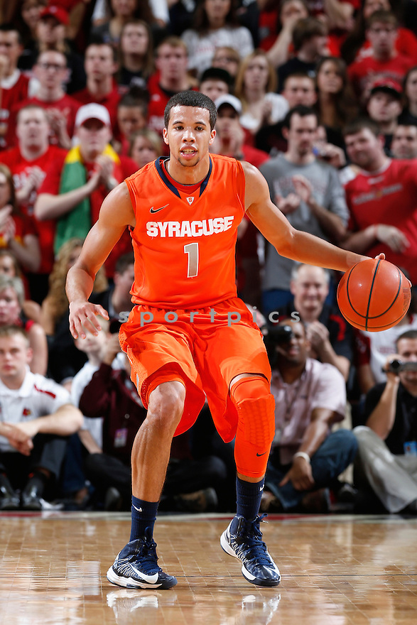 LOUISVILLE, KY - JANUARY 19: Michael Carter-Williams #1 of the Syracuse Orange brings the ball up court against the Louisville Cardinals during the game at KFC Yum! Center on January 19, 2013 in Louisville, Kentucky. Syracuse defeated Louisville 70-68. Michael Carter-Williams