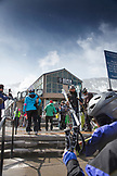 USA, Colorado, Aspen, skiers walk to the Gondola at the base of Aspen Mountain, Aspen Ski Resort, Ajax