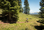 Cycling up one of the ski runs on the famous ski hill called Purgetory which is located outside of Durango CO.