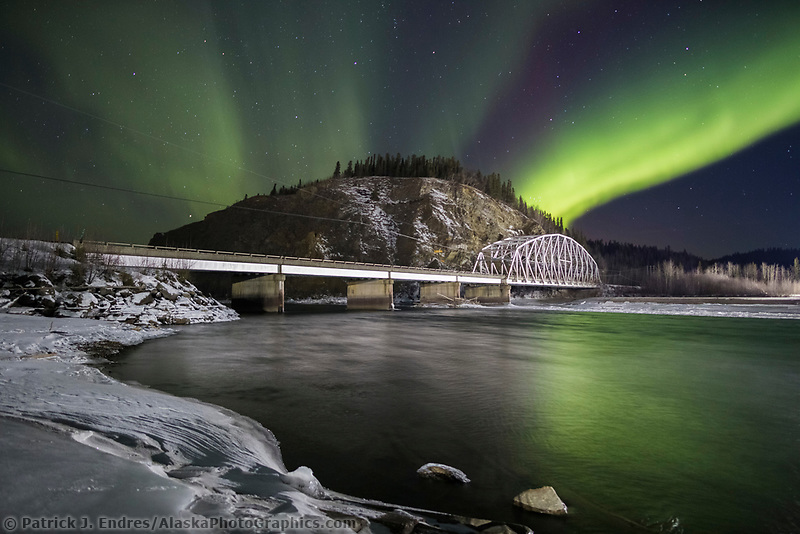 Northern lights over the Tanana river and the suspension bridge for the Trans Alaska Oil Pipeline in Delta Junction.