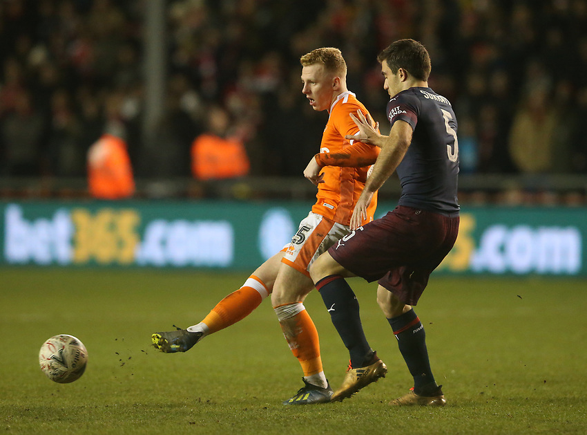 Blackpool's Callum Guy shields the ball from Arsenal's Sokratis Papastathopoulos<br /> <br /> Photographer Stephen White/CameraSport<br /> <br /> Emirates FA Cup Third Round - Blackpool v Arsenal - Saturday 5th January 2019 - Bloomfield Road - Blackpool<br />  <br /> World Copyright © 2019 CameraSport. All rights reserved. 43 Linden Ave. Countesthorpe. Leicester. England. LE8 5PG - Tel: +44 (0) 116 277 4147 - admin@camerasport.com - www.camerasport.com