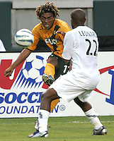 Los Angeles Galaxy's Guillermo Ramirez against New England Revolution's Marshall Leonard, July 4, 2005 at The Hime Depot Center.