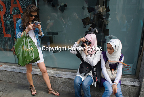 Tourists in Knightsbridge London 2009. Two young girls from Saudi Arabia on holiday.
