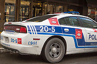 A police car with stickers protesting against bill 3 is pictured in Montreal Wednesday November 19, 2014. Policemen plastered with stickers their patrol cars in protest against Bill 3 on municipal pension reform plan.