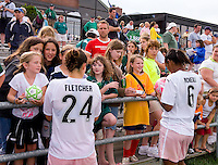 St Louis Athletica defender Kendall Fletcher (24) and Athletica defender Kia McNeill (6) signs autographs for fans after a WPS match at Anheuser-Busch Soccer Park, in St. Louis, MO, June 7, 2009. Athletica won the match 1-0.
