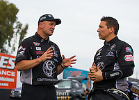 Feb 20, 2015; Chandler, AZ, USA; Team owner, Bob Vandergriff Jr (left) talks with NHRA top fuel driver Dave Connolly during qualifying for the Carquest Nationals at Wild Horse Pass Motorsports Park. Mandatory Credit: Mark J. Rebilas-