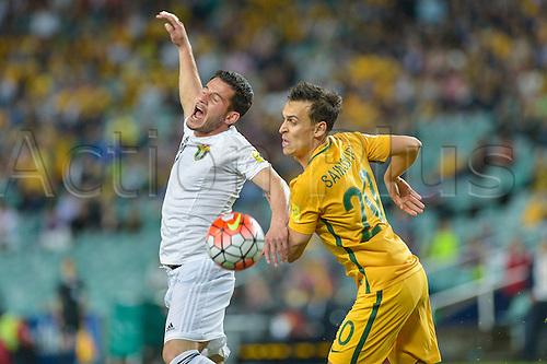 29.03.2016. Allianz Stadium, Sydney, Australia. Football 2018 World Cup Qualification match Australia versus Jordan. Jordan forward Yousef Al-Naber and Australian midfielder Tom Rogic in action. Australia won 5-1.