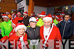 Miriam Pope, Mary Bonner and Paul Cusack, who took part in the Santa 5k fun run at Tralee Bay Wetlands on Sunday.